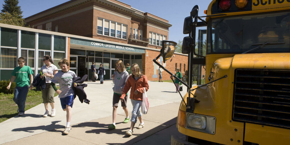 Students boarding buses at middle school